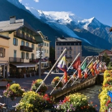 International flags fly over the River Arve in Chamonix, France,