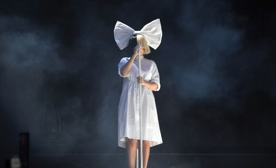 CHELMSFORD, ENGLAND - AUGUST 20: Sia performs at V Festival at Hylands Park on August 20, 2016 in Chelmsford, England. (Photo by Stuart C. Wilson/Getty Images)