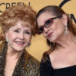 LOS ANGELES, CA - JANUARY 25:  Actress Debbie Reynolds (L), recipient of the Screen Actors Guild Life Achievement Award, and her daughter, actress Carrie Fisher, pose in the press room during the 21st Annual Screen Actors Guild Awards at The Shrine Auditorium on January 25, 2015 in Los Angeles, California.  (Photo by Ethan Miller/Getty Images)
